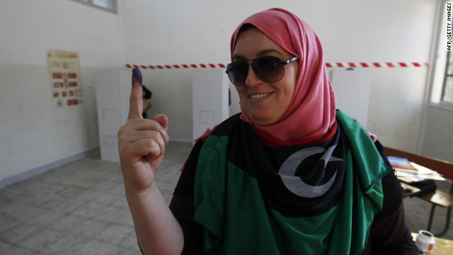 A Libyan woman shows her inked finger after casting her ballot at a polling station in Benghazi during Libya's General National Assembly election on Saturday.