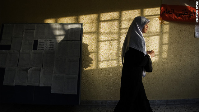 After casting her ballot, a Libyan woman leaves a polling station in Tripoli.