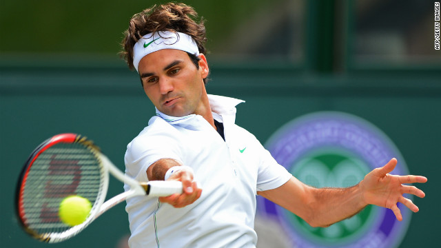 Federer returns a forehand to Murray during the first set.