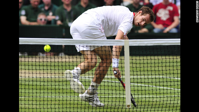 Murray reaches for a short shot by Federer on Sunday.