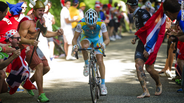 Fans cheer on Kessiakoff during the last major climb of the stage Sunday.
