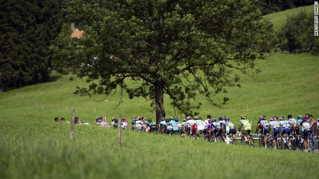The peloton makes its way through the narrow roads of the French countryside on the way to the stage finish in Porrentruy, Switzerland, on Sunday.