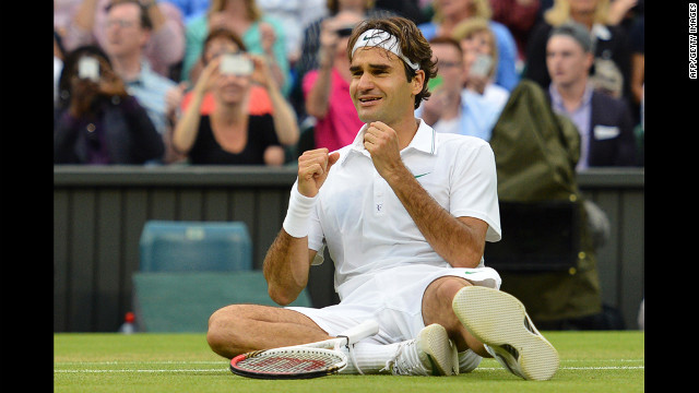 Roger Federer of Switzerland celebrates after defeating Andy Murray of Great Britain to win his 7th Wimbledon championship in London on Sunday, July 8. Visit &lt;a href='http://www.CNN.com/tennis' target='_blank'&gt;CNN.com/tennis&lt;/a&gt; for complete coverage.