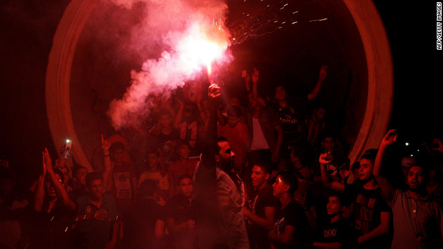 Libyans light up a flare Saturday, July 7, in Benghazi as they celebrate the country's first free national election in decades after the ouster of dictator Moammar Gadhafi.