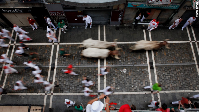 Participants run along Estafeta Street in Pamplona on Sunday, July 8.