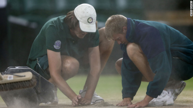 Great detail is taken as grounds crews prepare Centre Court for Sunday's historic match between Roger Federer and Andy Murray in the Wimbledon Championships at the All England Lawn Tennis and Croquet Club in London. Federer is seeking to tie the record for most men's singles titles at Wimbledon, and Murray is shooting to become the first British male to win his nation's major singles championship in 76 years. See the action as it unfolds here, and visit CNN.com/tennis for complete coverage.<br/><br/>
