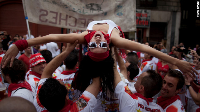 Revelers celebrate during the Pena Voladora parade on Estafeta Street on Saturday, July 7.