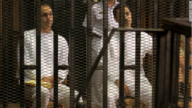 Gamal (left) and Alaa Mubarak, pictured during their trial on July 9, are accused of insider trading.