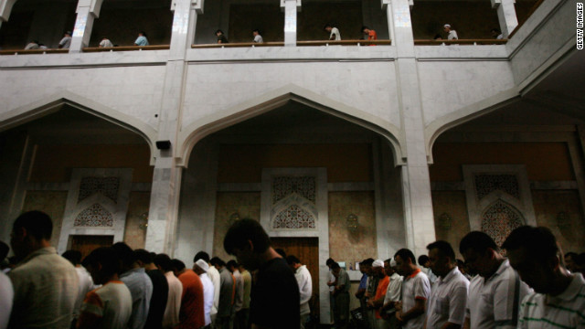 "Islamic worshippers perform their Friday prayers in the Great Mosque in Almaty. Sinai, who has been also photographed the Israeli-Palestinian conflict says the Islam in Kazakhstan is a ""different kind of Islam"" than the one he experienced elsewhere."