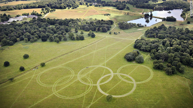 "With just days to go until the opening ceremony, organizers have cut Olympic rings into the grass in Richmond Park, south-west London, further promoting the green ambitions of the Games. David Stubbs, head of sustainability for London 2012 said: ""If you can put sustainability at the heart of a project which is the largest logistical exercise in peace time ... then you can do it anywhere.""<br/><br/>"