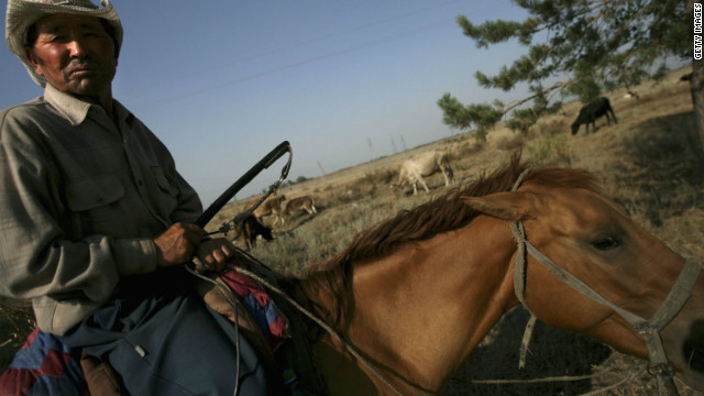A herdsman in central Kazakhstan watches his cows from horseback. Iran-born Sinai says the vast rural areas of central Kazakhstan reminded him of his motherland, a place he can not visit, as he is Israeli citizen.