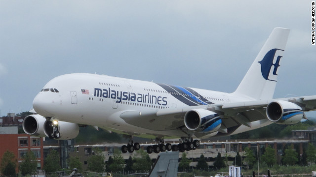 The Airbus 380 in Malaysia Airlines colors lands after a spectacular aerial performance of sweeping maneuvers at the Farnborough Airshow on Monday.