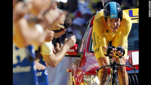 Team Sky rider Bradley Wiggins of Britain, in the leader's yellow jersey, crosses the finish line during the individual time trial in the ninth stage of the 99th Tour de France cycling race between Arc et Senans and Besancon on Monday, July 9.