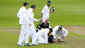 Wicketkeeper Mark Boucher kneels on the floor after being hit by a bail during South Africa's game with Somerset