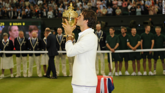 Roger Federer celebrates a record-equaling seventh Wimbledon triumph, a 17th grand slam title and a return to the top of the world rankings.