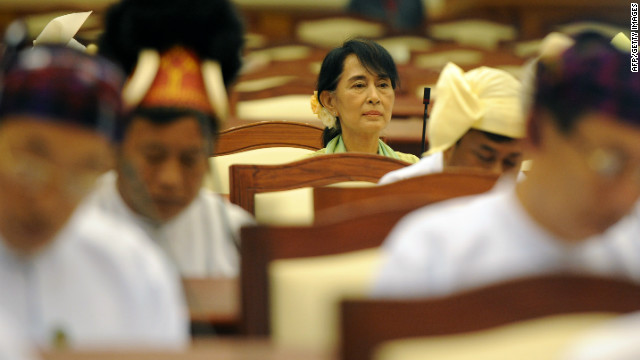 Aung San Suu Kyi sits in Myanmar's parliament this summer. Many say she cannot bring progress to her country by herself.