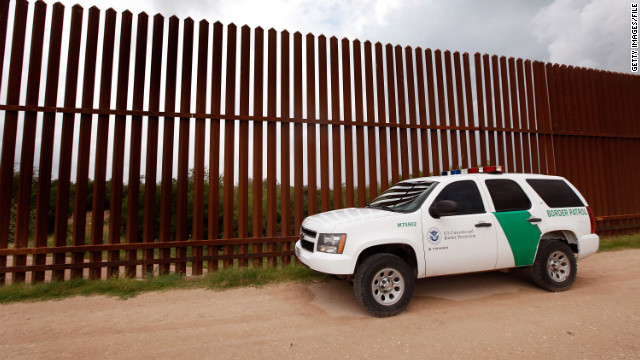 A Border Patrol agent watches an area of the U.S.-Mexico border along the Rio Grande in Texas in 2010.