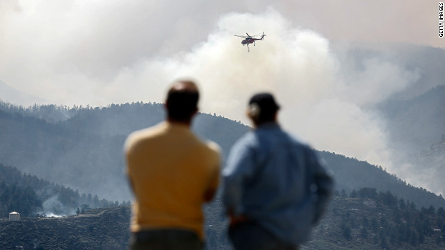 A helicopter circles as it prepares to drop water on a fire near Horsetooth Reservoir on June 11 near Laporte, Colorado.