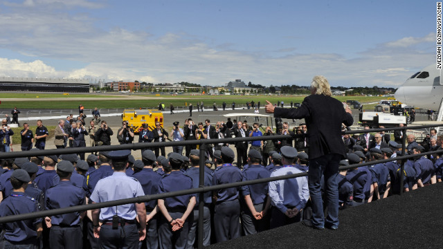 Virgin boss Richard Branson addresses crowds and press at the Farnborough Airshow on Wednesday.