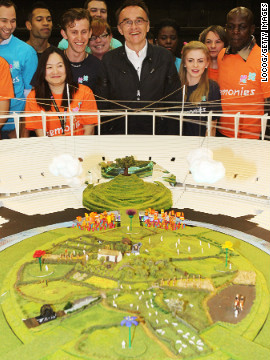 Film director Danny Boyle (center) is in charge of London's opening ceremony, which is set to feature artificial rain. Given the grim weather forecast, that may not be necessary.
