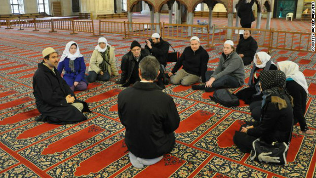 The tour group inside Istanbul's Blue Mosque, being taught Islamic practices.