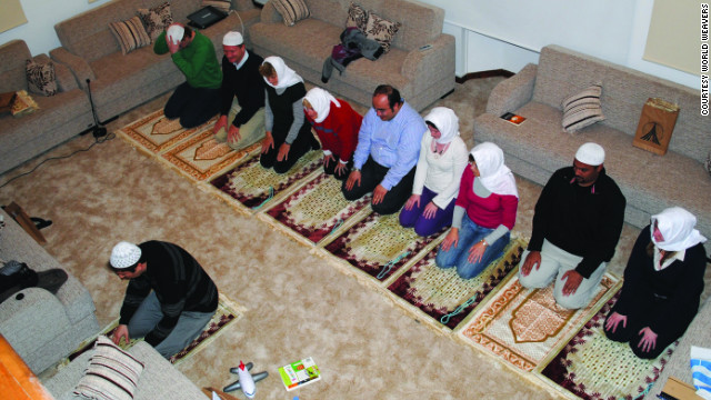 Tour participants are taught to pray in a private home in Istanbul.