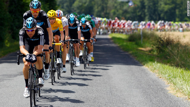 Bernhard Eisel of Austria and Team Sky drive the peloton as they work to defend Bradley Wiggins' hold on the overall race lead Wednesday.