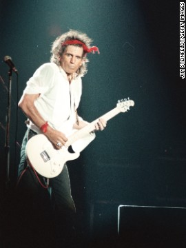 Guitarist Keith Richards performs at the Aragone Ballroom in Chicago, Illinois, in 1987. The songwriter collaborated with Mick Jagger on their first international number 1 hit &quot;(I can't get no) Satisfaction&quot; in 1965.