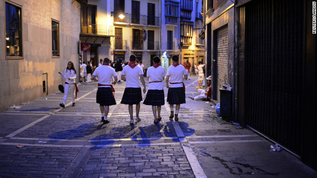 Scottish runners from Glasgow and Aberdeen wearing kilts walk through the streets of Pamplona before the sixth day of festivities Thursday morning.