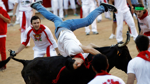 A man is thrown by a bull during the sixth day of the running of the bulls at the San Fermin festival on Thursday, July 12. 