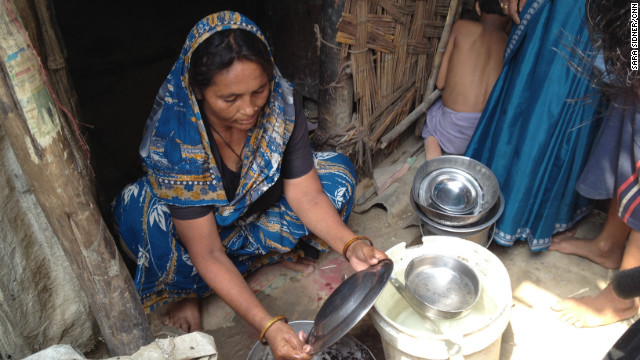 Mother of six Shazadi washes dishes outside her home on the outskirts of the Indian capital, New Delhi. She tries to use as little water as possible, because it is in short supply.