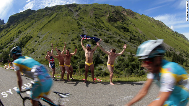 Australian fans cheer riders as they pass by during Thursday's race, the first full stage in the Alps.