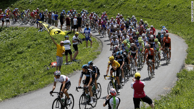 Riders make their way through the French Alps on Thursday during the 11th stage of the Tour de France, which covers 91 miles starting in Albertville and finishes in La Toussuire-Les Sybelles, France.
