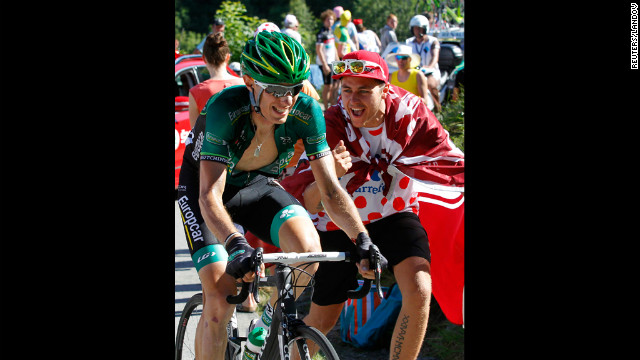 Team Europcar rider Pierre Rolland of France is cheered on Thursday, July 12, as he rides to victory in stage 11.