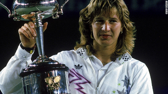 Graf holds aloft the 1988 Australian Open title, the first leg of her &quot;Golden Slam&quot; that year.