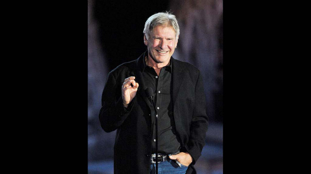 Harrison Ford presents the best director award onstage during Spike TV's Scream 2009 held at the Greek Theatre in Los Angeles, California. 