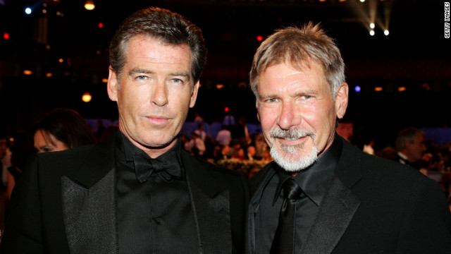 Pierce Brosnan and Harrison Ford pose during the 34th AFI Life Achievement Award tribute to Sir Sean Connery.