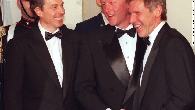 Harrison Ford is greeted by President Bill Clinton and British Prime Minister Tony Blair in the receiving line at the White House during a state dinner held in 2005.