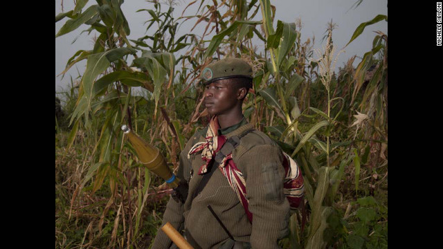 An M23 rebel soldier poses at a FARDC base in Rumangabo on July 9. Congolese M23 mutineers were pulled out of the key eastern town of Rutshuru, near the borders with Uganda and Rwanda a day after seizing it. 