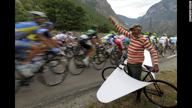 A fan cheers on the pack riding in the 226-km (140-mile) stage 12 of the 2012 Tour de France, starting in Saint-Jean-de-Maurienne and finishing in Annonay Davezieux, southeastern France, on Friday, July 13.