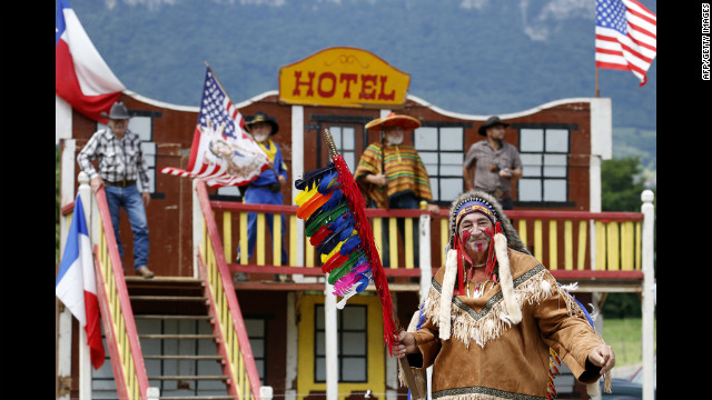 Fans wait for riders in Western garb during stage 12 Friday.