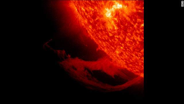 This close-up view of a prominence reveals magnetic forces at work as they pull plasma strands this way and that before it gradually breaks away from the sun over a one-day period November 14-15, 2011.