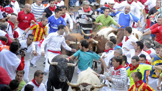 Participants run during the last day of the Running of the Bulls on Saturday, July 14, in Pamplona, Spain. The dangerous tradition has tallied thousands of injuries and 15 deaths since record-keeping began in 1924, including the fatal goring of a Spanish man in 2009.