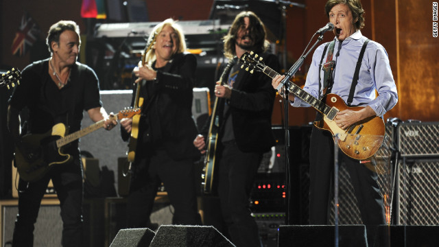 He was joined for the finale by Beatles legend Paul McCartney. The two, seen here with Joe Walsh and Dave Grohl at the Grammys in February, played &quot;I Saw Her Standing There&quot; and &quot;Twist and Shout&quot; before the power was pulled by concert organizers.