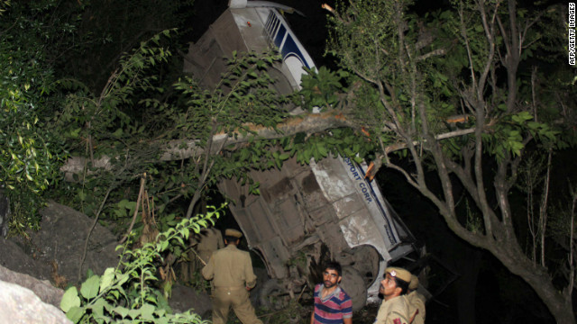 Indian police stand pictured at the scene of a bus accident near Digdole, about 165 kms from Jammu.