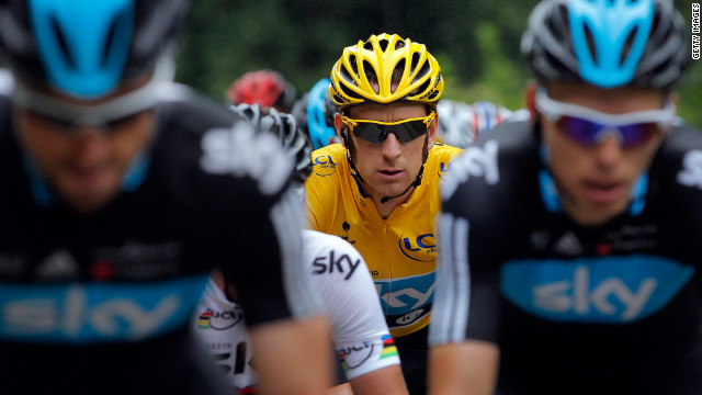Bradley Wiggins of Great Britain, wearing the yellow jersey, maintains his position as the overall race leader, 2 minutes 5 seconds ahead of Team Sky teammate Christopher Froome, on Sunday.