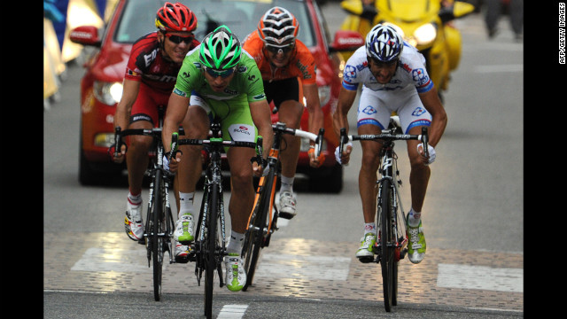 Slovakia's Peter Sagan, wearing the green jersey of the sprint points leader, reaches for second place at the finish of the race Sunday and maintains his lead as sprints points leader, 97 points ahead of Andre Greipel of Germany.