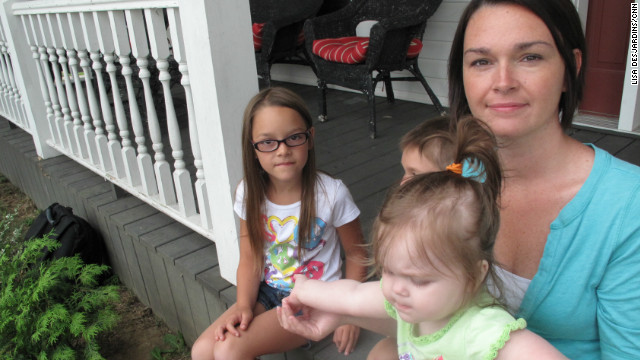 Amanda Sedgmer, with her kids in Hopedale, Ohio, worries about the survival of the coal industry and her family's way of life.