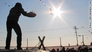 Barrow, Alaska, residents enjoy a traditional blanket toss. The community is wrestling with the idea of proposed off-shore oil rigs. 