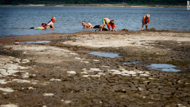 Swimmers relax in the shallow waters of the Mississippi River at Meeman-Shelby Forest State Park in Tennessee on July 6. Drought conditions have lowered the river's levels considerably from this time last year. 